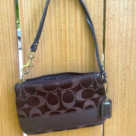Coach coin purse that can be used as a mini purse
